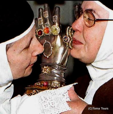 Nuns Kissing the Hand of Santa Teresa